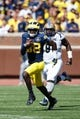 Sep 14, 2013; Ann Arbor, MI, USA; Michigan Wolverines quarterback Devin Gardner (98) runs the ball against the Akron Zips at Michigan Stadium. Mandatory Credit: Rick Osentoski-USA TODAY Sports