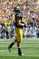 Sep 14, 2013; Ann Arbor, MI, USA; Michigan Wolverines linebacker Desmond Morgan (48) reacts after the game against the Akron Zips at Michigan Stadium. Michigan won 28-24. Mandatory Credit: Rick Osentoski-USA TODAY Sports