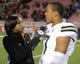 Oct 3, 2013; Salt Lake City, UT, USA; Fox Sports sideline reporter Kristina Pink (left) interviews UCLA Bruins quarterback Brett Hundley (17) after the game against the Utah Utes at Rice-Eccles Stadium. UCLA defeated Utah 34-27. Mandatory Credit: Kirby Lee-USA TODAY Sports