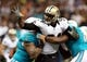 Sep 30, 2013; New Orleans, LA, USA; New Orleans Saints defensive end Cameron Jordan (94) works against the Miami Dolphins offensive linemen during their game at the Mercedes-Benz Superdome. Mandatory Credit: Chuck Cook-USA TODAY Sports