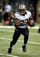 Sep 30, 2013; New Orleans, LA, USA; New Orleans Saints running back Pierre Thomas (23) runs with the football against the Miami Dolphins during the first quarter at the Mercedes-Benz Superdome. Mandatory Credit: Chuck Cook-USA TODAY Sports