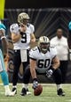 Sep 30, 2013; New Orleans, LA, USA; New Orleans Saints center Brian De La Puente (60) prepares to snap the ball to quarterback Drew Brees (9) during their game against the Miami Dolphins at the Mercedes-Benz Superdome. Mandatory Credit: Chuck Cook-USA TODAY Sports