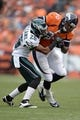 Sep 29, 2013; Denver, CO, USA; Philadelphia Eagles cornerback Cary Williams (26) tackles Denver Broncos tight end Julius Thomas (80) after a reception  in the fourth quarter at Sports Authority Field at Mile High. Mandatory Credit: Ron Chenoy-USA TODAY Sports