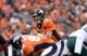 Sep 29, 2013; Denver, CO, USA; Denver Broncos quarterback Peyton Manning (18) at the line of scrimmage during the game against the Philadelphia Eagles at Sports Authority Field at Mile High. Mandatory Credit: Ron Chenoy-USA TODAY Sports