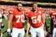 Sep 29, 2013; Kansas City, MO, USA; Kansas City Chiefs defensive end Mike DeVito (70) and center Eric Kush (64) after the game against the New York Giants at Arrowhead Stadium. Kansas City won the game 31-7. Mandatory Credit: John Rieger-USA TODAY Sports