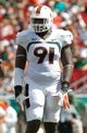 Sep 28, 2013; Tampa, FL, USA; Miami Hurricanes defensive lineman Olsen Pierre (91) against the South Florida Bulls during the first half at Raymond James Stadium. Mandatory Credit: Kim Klement-USA TODAY Sports