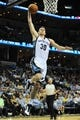 Oct 9, 2013; Memphis, TN, USA; Memphis Grizzlies power forward Jon Leuer (30) dunks the ball against the Dallas Mavericks in the 2nd quarter at FedExForum. Mandatory Credit: Justin Ford-USA TODAY Sports