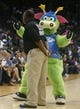 Oct 9, 2013; Jacksonville, FL, USA; Orlando Magic mascot Stuff dances next to a security guard in the second half of their game against the New Orleans Pelicans at Jacksonville Veterans Memorial Arena. The New Orleans Pelicans beat the Orlando Magic 99-95. Mandatory Credit: Phil Sears-USA TODAY Sports