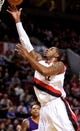 Oct 9, 2013; Portland, OR, USA; Portland Trail Blazers center LaMarcus Aldridge (12) shoots against the Phoenix Suns in the first quarter at the Moda Center. Mandatory Credit: Craig Mitchelldyer-USA TODAY Sports