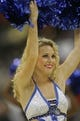 Oct 9, 2013; Jacksonville, FL, USA; An Orlando Magic cheerleader performs in the second half of their game against the New Orleans Pelicans at Jacksonville Veterans Memorial Arena. The New Orleans Pelicans beat the Orlando Magic 99-95. Mandatory Credit: Phil Sears-USA TODAY Sports