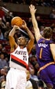 Oct 9, 2013; Portland, OR, USA; Portland Trail Blazers point guard Mo Williams (25) shoots over Phoenix Suns point guard Goran Dragic (1) at the Moda Center. Mandatory Credit: Craig Mitchelldyer-USA TODAY Sports