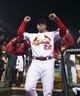 Oct 9, 2013; St. Louis, MO, USA; St. Louis Cardinals manager Mike Matheny (22) celebrates after defeating the Pittsburgh Pirates in game five of the National League divisional series playoff baseball game at Busch Stadium. The Cardinals won 6-1. Mandatory Credit: Scott Rovak-USA TODAY Sports