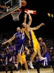 Oct 10, 2013; Las Vegas, NV, USA; Los Angeles Lakers guard Steve Blake (5) attempts to tip in a back handed shot as Sacramento Kings guard Jimmer Fredette (7) defends the basket during an NBA preseason game at MGM Grand Arena. Mandatory Credit: Stephen R. Sylvanie-USA TODAY Sports