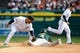 Oct 7, 2013; Detroit, MI, USA; Oakland Athletics center fielder Coco Crisp (4) slides in to steal second base while Detroit Tigers second baseman Omar Infante (4) tries to get him out in the third inning in game three of the American League divisional series playoff baseball game at Comerica Park. Mandatory Credit: Rick Osentoski-USA TODAY Sports