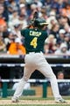 Oct 7, 2013; Detroit, MI, USA; Oakland Athletics center fielder Coco Crisp (4) at bat against the Detroit Tigers in game three of the American League divisional series playoff baseball game at Comerica Park. Mandatory Credit: Rick Osentoski-USA TODAY Sports