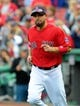 Oct 4, 2013; Boston, MA, USA; Boston Red Sox right fielder Shane Victorino (18) is introduced to the crowd prior to game one of the American League divisional series playoff baseball game against the Tampa Bay Rays at Fenway Park. Mandatory Credit: Bob DeChiara-USA TODAY Sports