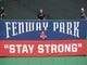 Oct 4, 2013; Boston, MA, USA; A stay strong sign hangs in center field in game one of the American League divisional series playoff baseball game between the Boston Red Sox and Tampa Bay Rays at Fenway Park. Mandatory Credit: Bob DeChiara-USA TODAY Sports