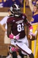 Oct 5, 2013; Starkville, MS, USA; Mississippi State Bulldogs wide receiver De'Runnya Wilson (81) reacts after scoring a touchdown during the game against the LSU Tigers at Davis Wade Stadium.  LSU Tigers defeated the Mississippi State Bulldogs 59-26.  Mandatory Credit: Spruce Derden-USA TODAY Sports