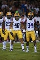 Oct 5, 2013; Starkville, MS, USA; LSU Tigers linebacker Lamar Louis (23) linebacker Duke Riley (40) and safety Micah Eugene (34) line up for a kickoff during the game against the Mississippi State Bulldogs at Davis Wade Stadium.  LSU Tigers defeated the Mississippi State Bulldogs 59-26.  Mandatory Credit: Spruce Derden-USA TODAY Sports