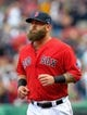 Oct 4, 2013; Boston, MA, USA; Boston Red Sox first baseman Mike Napoli (12) is introduced to the crowd prior to game one of the American League divisional series playoff baseball game against the Tampa Bay Rays at Fenway Park. Mandatory Credit: Bob DeChiara-USA TODAY Sports
