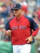 Oct 4, 2013; Boston, MA, USA; Boston Red Sox manager John Farrell (53) in introduced to the crowd prior to game one of the American League divisional series playoff baseball game against the Tampa Bay Rays at Fenway Park. Mandatory Credit: Bob DeChiara-USA TODAY Sports