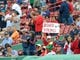Oct 4, 2013; Boston, MA, USA; A fan holds a sign prior to game one of the American League divisional series playoff baseball game between the Boston Red Sox and Tampa Bay Rays at Fenway Park. Mandatory Credit: Bob DeChiara-USA TODAY Sports