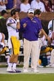 Oct 5, 2013; Starkville, MS, USA; LSU Tigers head coach Les Miles has a discussion with LSU Tigers quarterback Brad Kragthorpe (16) during the game against the Mississippi State Bulldogs at Davis Wade Stadium.  LSU Tigers defeated the Mississippi State Bulldogs 59-26.  Mandatory Credit: Spruce Derden-USA TODAY Sports
