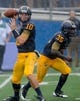 Oct 5, 2013; Kent, OH, USA; Kent State Golden Flashes quarterback Colin Reardon (10) and running back Julian Durden (35) against the Northern Illinois Huskies at Dix Stadium. Northern Illinois beat Kent State 38-24. Mandatory Credit: Ken Blaze-USA TODAY Sports
