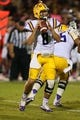 Oct 5, 2013; Starkville, MS, USA; LSU Tigers quarterback Zach Mettenberger (8) drops back for a pass during the game against the Mississippi State Bulldogs at Davis Wade Stadium.  LSU Tigers defeated the Mississippi State Bulldogs 59-26.  Mandatory Credit: Spruce Derden-USA TODAY Sports