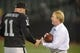 Oct 6, 2013; Oakland, CA, USA; Oakland Raiders owner Mark Davis (right) shakes hands with kicker Sebastian Janikowski (11) before the game against the San Diego Chargers at O.co Coliseum. The Raiders defeated the Chargers 27-17. Mandatory Credit: Kirby Lee-USA TODAY Sports