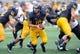 Oct 5, 2013; Kent, OH, USA; Kent State Golden Flashes quarterback Colin Reardon (10) against the Northern Illinois Huskies at Dix Stadium. Northern Illinois beat Kent State 38-24. Mandatory Credit: Ken Blaze-USA TODAY Sports