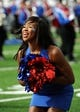 Oct 5, 2013; Lawrence, KS, USA; A Kansas Jayhawks cheerleader performs before the game with the Texas Tech Red Raiders at Memorial Stadium. Texas Tech won the game 54-16. Mandatory Credit: John Rieger-USA TODAY Sports