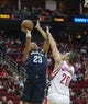 Oct 5, 2013; Houston, TX, USA; New Orleans Pelicans power forward Anthony Davis (23) shoots during the first quarter as Houston Rockets power forward Donatas Motiejunas (20) defends at Toyota Center. Mandatory Credit: Troy Taormina-USA TODAY Sports