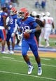 Oct 5, 2013; Lawrence, KS, USA; Kansas Jayhawks running back James Sims (29) warms up before the game against the Texas Tech Red Raiders at Memorial Stadium. Texas Tech won the game 54-16. Mandatory Credit: John Rieger-USA TODAY Sports