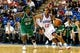 Oct 11, 2013; Newark, DE, USA; Philadelphia 76ers guard Evan Turner (12) is defended by Boston Celtics forward Gerald Wallace (45) during the fourth quarter at Bob Carpenter Sports Convocation Center. The Sixers defeated the Celtics 97-85. Mandatory Credit: Howard Smith-USA TODAY Sports