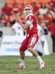Oct 12, 2013; Houston, TX, USA; Houston Cougars quarterback John O'Korn (5) looks for an open receiver during the first quarter against the Memphis Tigers at BBVA Compass Stadium. Mandatory Credit: Troy Taormina-USA TODAY Sports