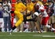 Oct 12, 2013; Laramie, WY, USA; Laramie, WY, USA; Wyoming Cowboys wide receiver Robert Herron (6) makes a reception against New Mexico Lobos cornerback SaQwan Edwards (15) during the first quarter at War Memorial Stadium. Mandatory Credit: Troy Babbitt-USA TODAY Sports