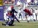 Oct 12, 2013; Fort Worth, TX, USA; Kansas Jayhawks receiver Brandon Bourbon (25) is upended by TCU Horned Frogs cornerback Keivon Gamble (16) at Amon G. Carter Stadium. TCU defeated Kansas 27-17. Mandatory Credit: Kirby Lee-USA TODAY Sports