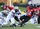 Oct 12, 2013; DeKalb, IL, USA; Northern Illinois Huskies running back Cameron Stingily (42) rushes the ball against Akron Zips linebacker Justin March (5) during the first half at Huskie Stadium. Mandatory Credit: Mike DiNovo-USA TODAY Sports