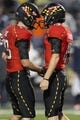 Oct 12, 2013; College Park, MD, USA; Maryland Terrapins kicker Brad Craddock (15) is congratulated by holder Michael Tart (29) after kicking an extra point that provided the game winning margin against the Virginia Cavaliers at Byrd Stadium. Mandatory Credit: Mitch Stringer-USA TODAY Sports