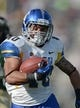 Oct 12, 2013; Fort Collins, CO, USA; San Jose State Spartans running back Jarrod Lawson (40) rushes for a eighteen yard touchdown in the third quarter against the Colorado State Rams at Hughes Stadium. The Spartans defeated the Rams 34-27. Mandatory Credit: Ron Chenoy-USA TODAY Sports