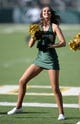 Oct 12, 2013; Fort Collins, CO, USA; Colorado State Rams cheerleader performs in the second quarter against the San Jose State Spartans at Hughes Stadium. The Spartans defeated the Rams 34-27. Mandatory Credit: Ron Chenoy-USA TODAY Sports