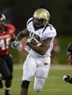 Oct 12, 2013; DeKalb, IL, USA; Akron Zips running back Jawon Chisholm (7) rushes the ball against the Northern Illinois Huskies during the second half at Huskie Stadium. Northern Illinois defeats Akron 27-20. Mandatory Credit: Mike DiNovo-USA TODAY Sports