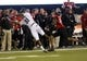 Oct 12, 2013; DeKalb, IL, USA; Akron Zips wide receiver Tyrell Goodman (81) attempts to make a catch against Northern Illinois Huskies cornerback Marlon Moore (21) during the second half at Huskie Stadium. Northern Illinois defeats Akron 27-20. Mandatory Credit: Mike DiNovo-USA TODAY Sports