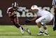 Oct 12, 2013; Starkville, MS, USA; MIssissippi State Bulldogs running back Brandon Holloway (10) pushes away Bowling Green Falcons defensive lineman Jhalil-Nashid Croley (45) at Davis Wade Stadium. Mandatory Credit: Marvin Gentry-USA TODAY Sports