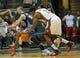 Oct 12, 2013; Milwaukee, WI, USA;   Charlotte Bobcats guard Kemba Walker (15) fouls Milwaukee Bucks guard Brandon Knight (11) in the 1st period at BMO Harris Bradley Center. Mandatory Credit: Benny Sieu-USA TODAY Sports