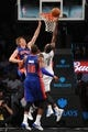 Oct 12, 2013; Brooklyn, NY, USA; Brooklyn Nets power forward Andray Blatche (0) lays up against the Detroit Pistons during the second half of the preseason game at Barclays Center. The Pistons won the game 99-88 Mandatory Credit: Joe Camporeale-USA TODAY Sports