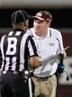 Oct 12, 2013; Starkville, MS, USA; Mississippi State Bulldogs Head Coach Dan Mullen gets in the face of the official to get his attention about a call during the first half of the game against the Bowling Green Falcons at Davis Wade Stadium. Mandatory Credit: Marvin Gentry-USA TODAY Sports