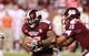 Oct 12, 2013; Starkville, MS, USA; Mississippi State Bulldogs quarterback Dak Prescott (15) hands the ball off to running back LaDarious Perkins (27) during the game against the Bowling Green Falcons at Davis Wade Stadium. The Bulldogs defeated the Falcons 21-20. Mandatory Credit: Marvin Gentry-USA TODAY Sports