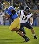 Oct 12, 2013; Pasadena, CA, USA; UCLA Bruins quarterback Brett Hundley (17) runs past California Golden Bears defensive lineman Kyle Kragen (13) during second quarter action at Rose Bowl.  Mandatory Credit: Robert Hanashiro-USA TODAY Sports